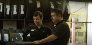 two men in a tyre shop