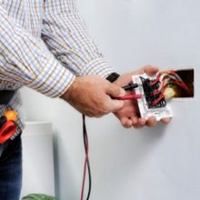 Electrician working on powerpoint wiring